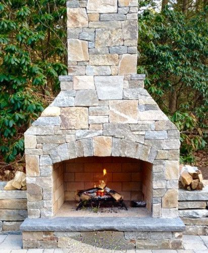 outdoor fireplace with stone feature