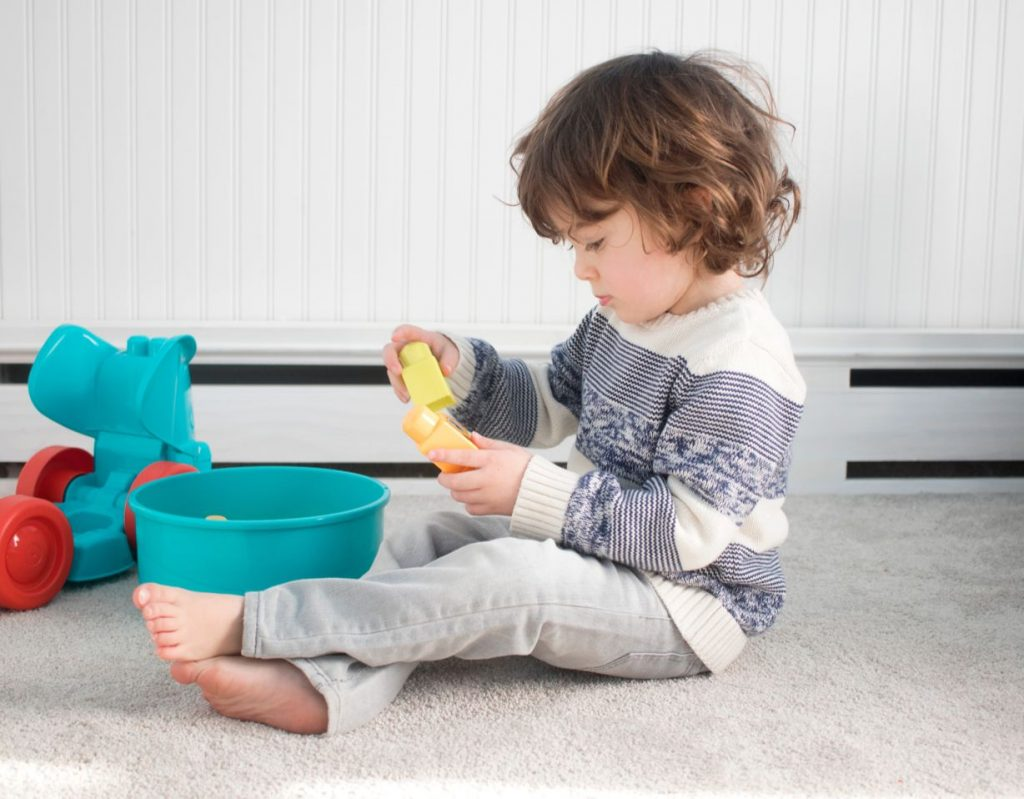 kid playing on soft carpet