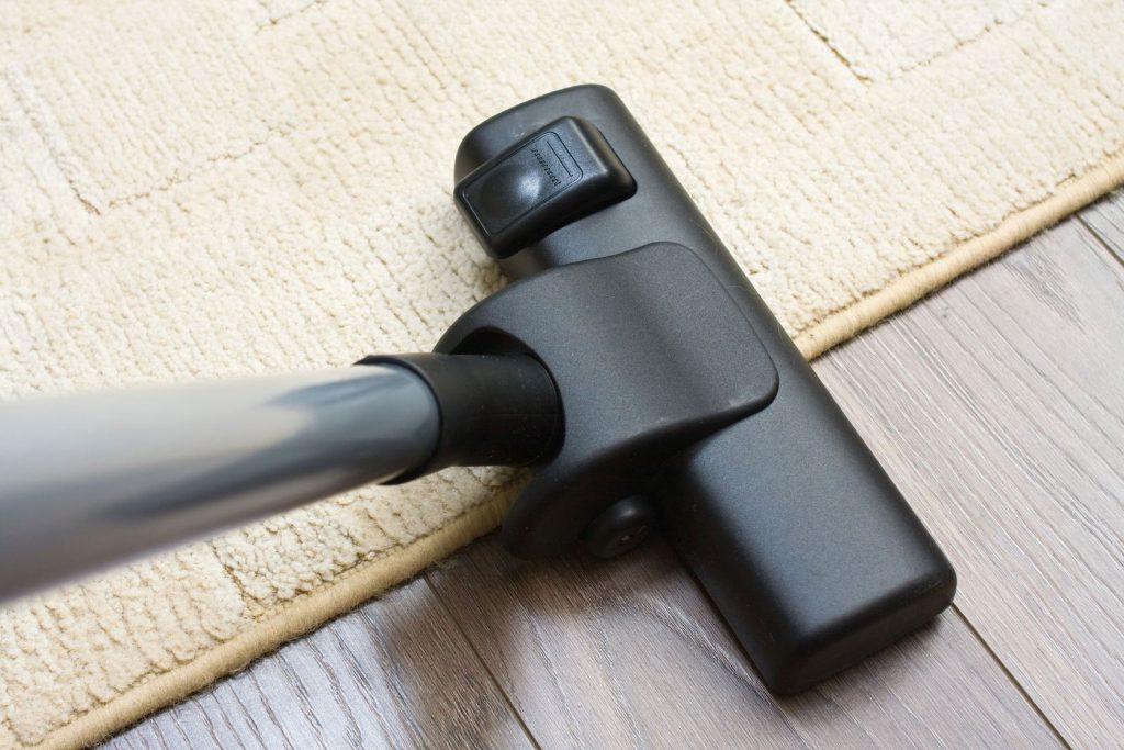 vacuuming edges of area rug