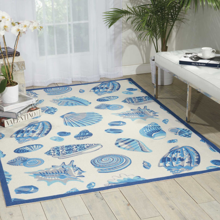seashell themed area rug in blue