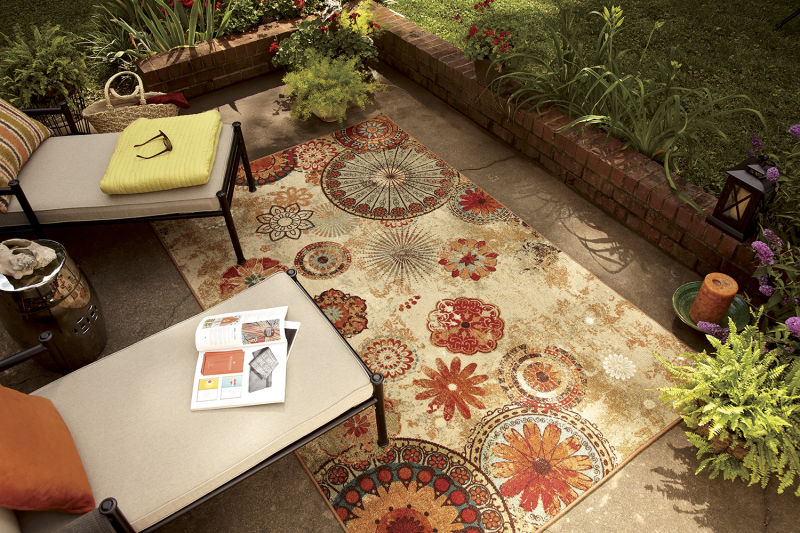 floral print area rug on outdoor patio