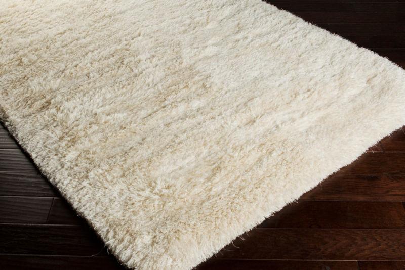 plush mat on top of hardwood flooring
