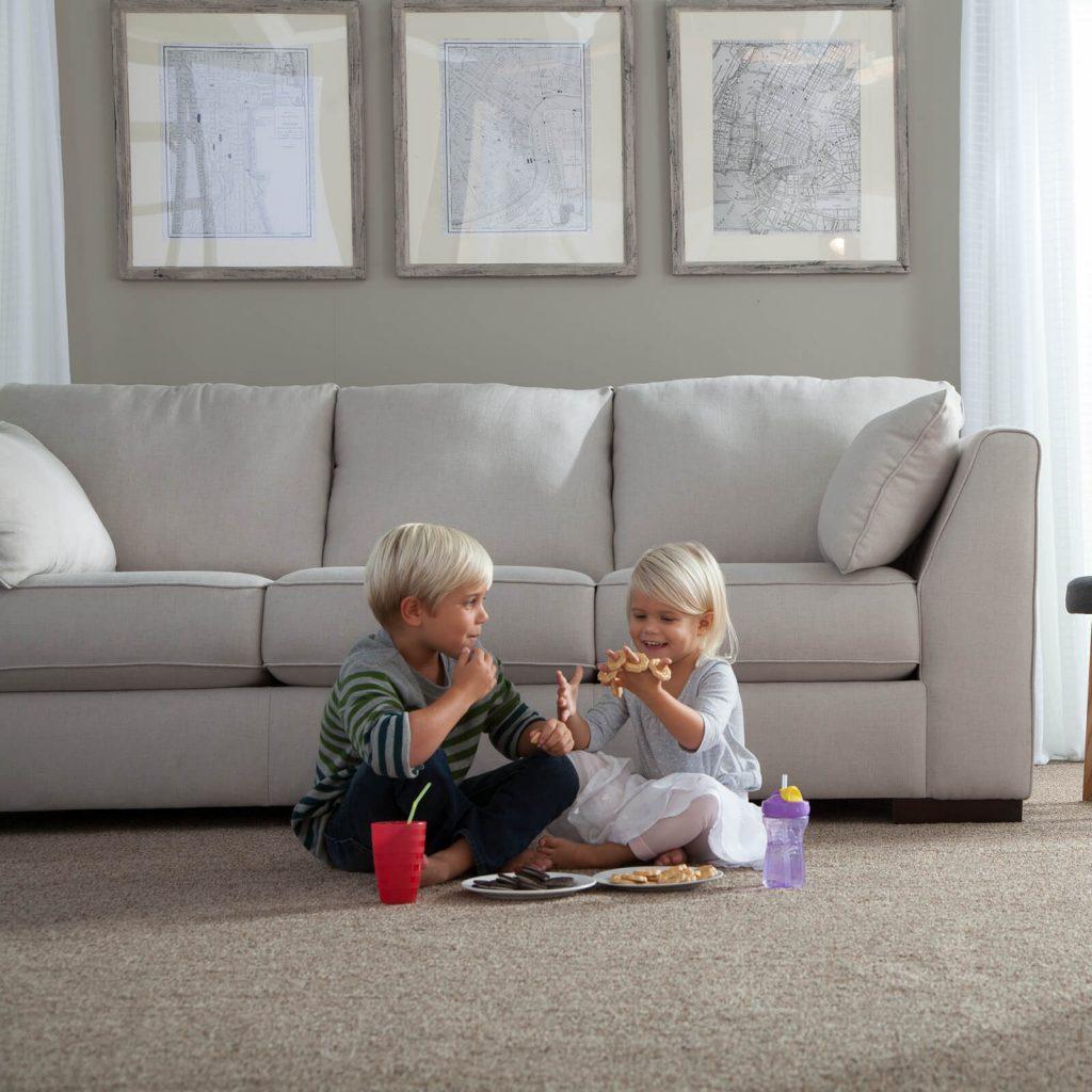 children sitting together on carpet