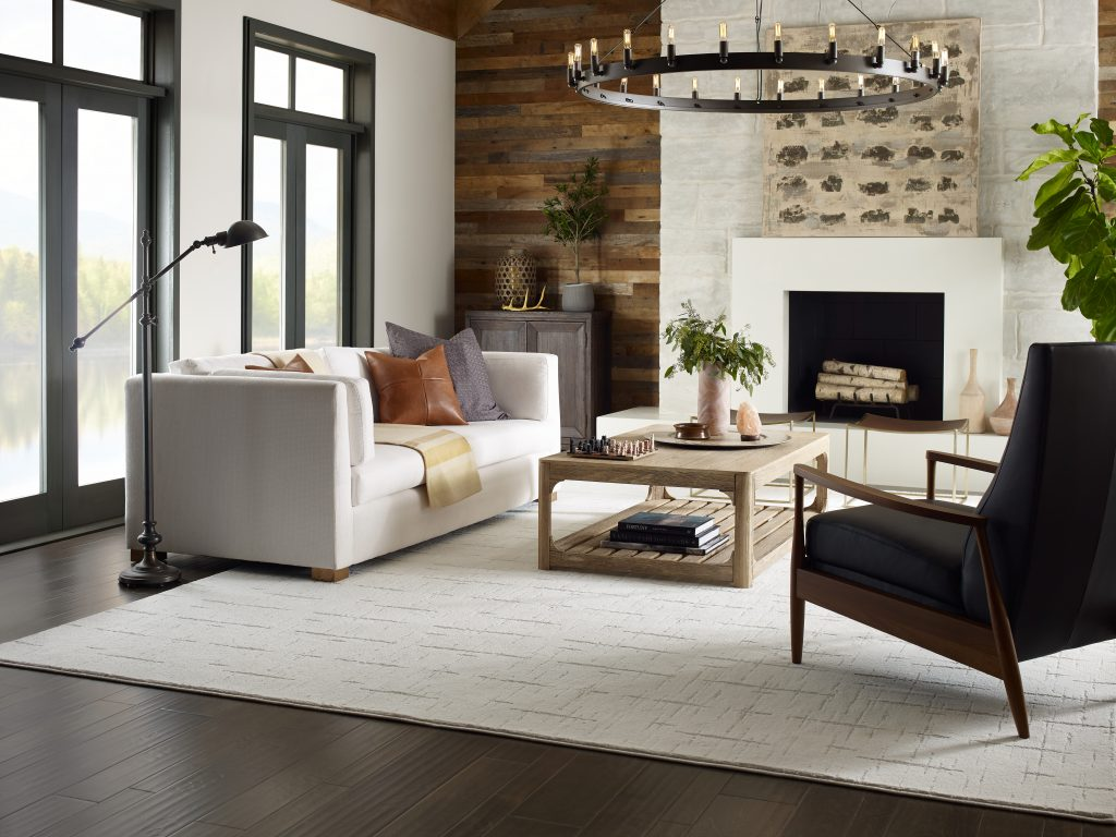 living room with accent wall and fireplace