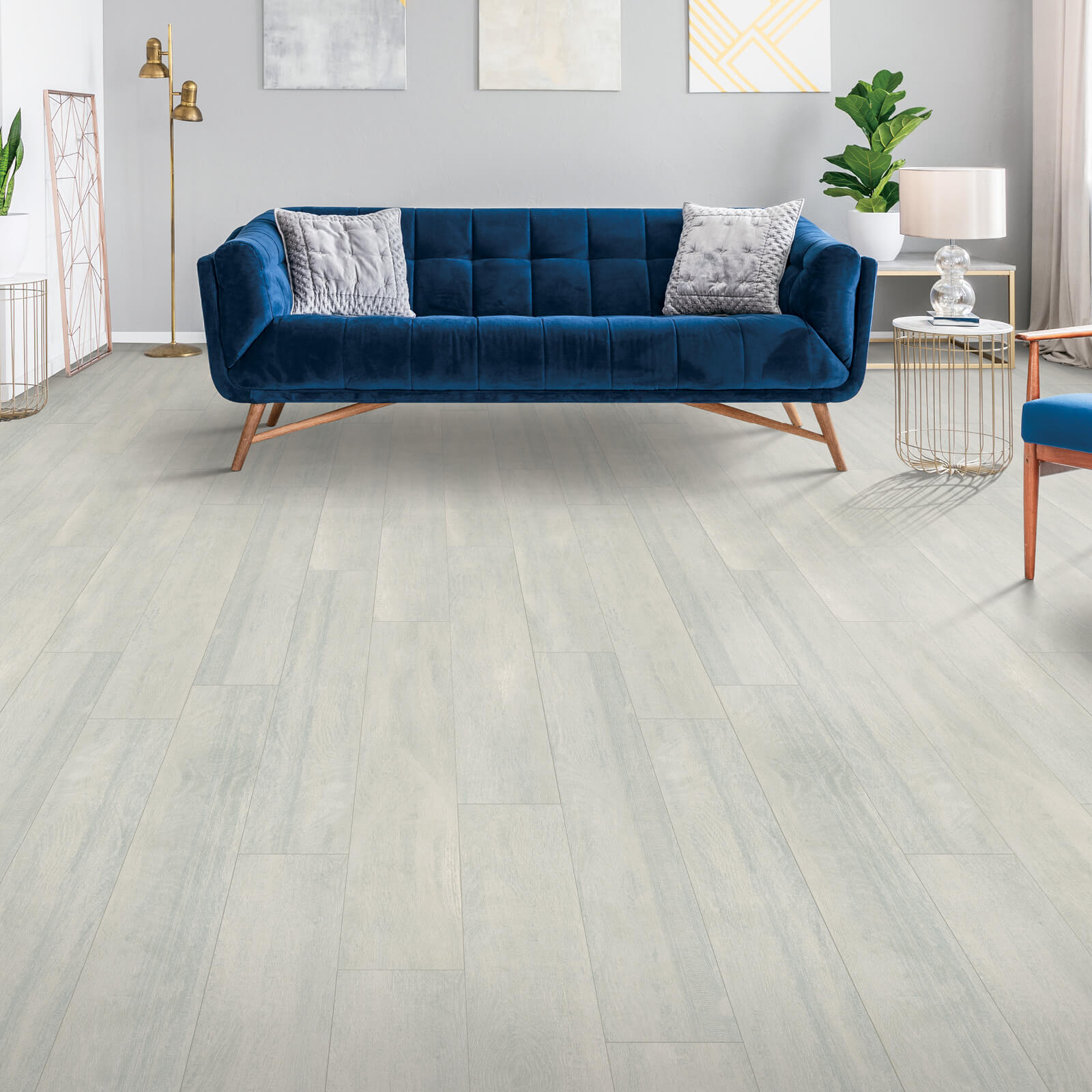 Blue couch on Laminate flooring | Dolphin Carpet & Tile