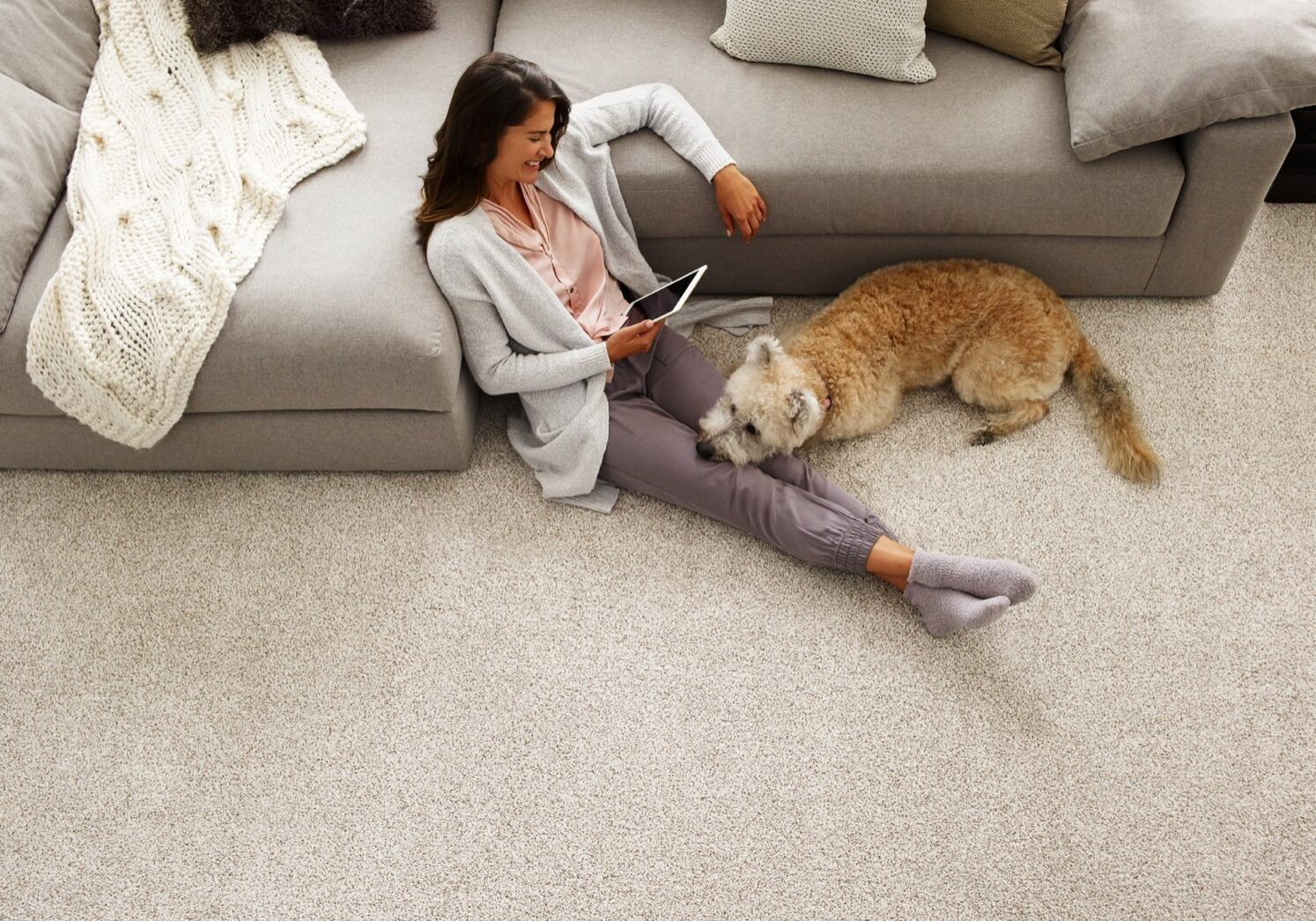 woman and dog on carpet   Dolphin Carpet & Tile
